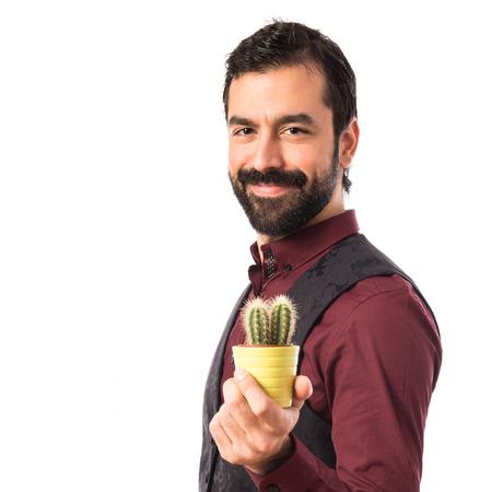 waistcoat: Man wearing waistcoat holding a cactus