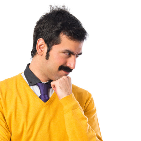 white moustache: Man with moustache thinking over white background