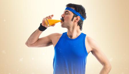 Vintage sportman drinking orange juice photo