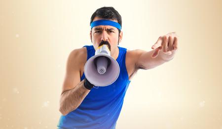 sportman: Sportman shouting by megaphone