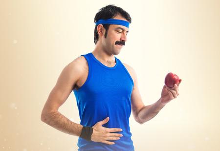 sportman: Sportman holding an apple