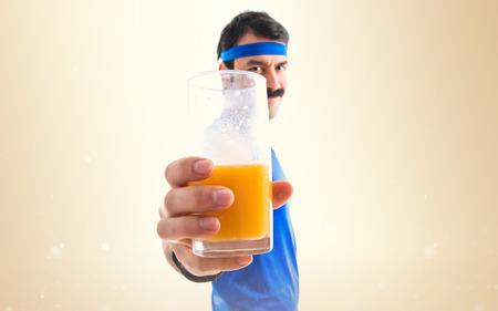 sportman: Sportman with orange juice Stock Photo
