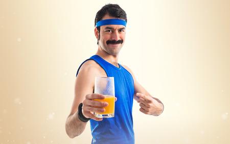 Vintage sportman with orange juice photo