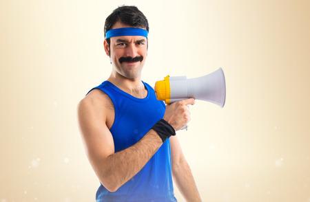 Sportman shouting by megaphone Stock Photo - 39056162