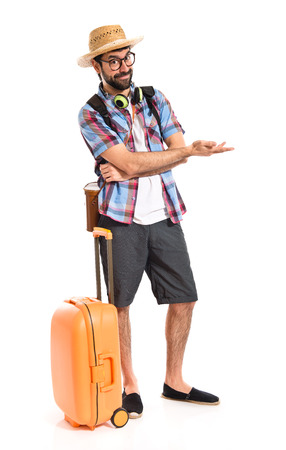 Tourist presenting something Stock Photo
