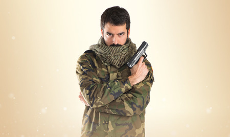 special service agent: Soldier holding a gun