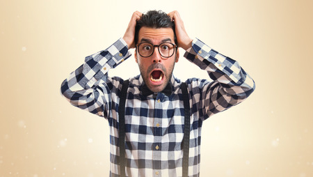 preppy: frustrated posh boy over white background Stock Photo