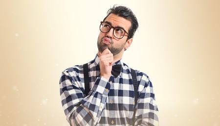 posh: Posh boy thinking over white background