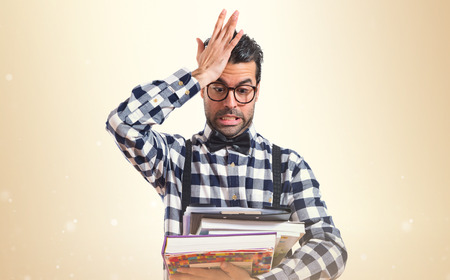 posh: Surprised posh boy holding books