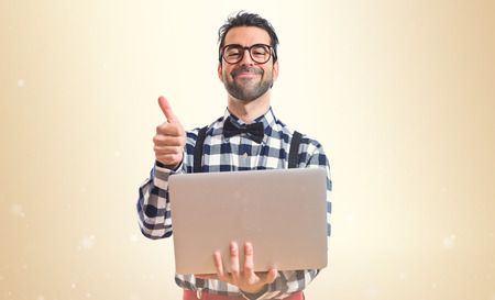 open up: Posh boy with laptop over white background