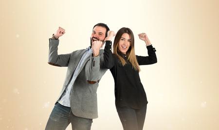Couple Gewinner auf weißem Hintergrund Standard-Bild - 39309707