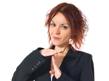 Redhead girl making time out gesture