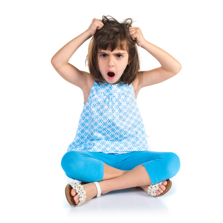 frustrated girl over white background photo