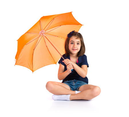 Girl holding an umbrella photo