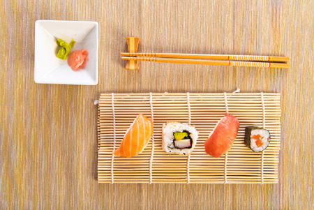 Maki Sushi set on wooden background photo