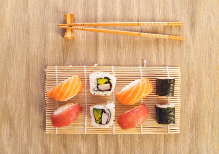 sushi: Maki Sushi set on wooden background Stock Photo