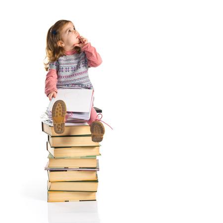Girl thinking over books photo