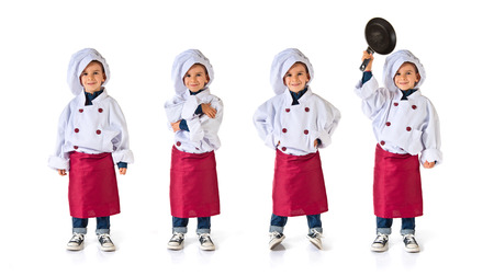 child dressed as a chef with his arms crossed photo