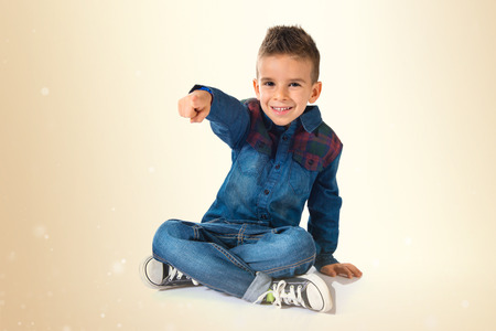 kid pointing: Kid pointing to the front over white background Stock Photo