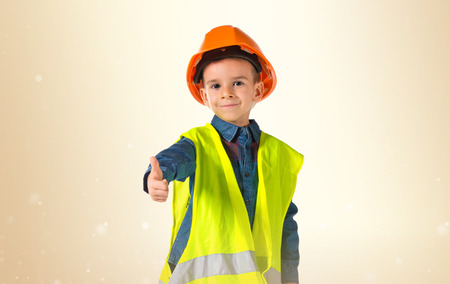 child dressed as a workman with thumb up photo