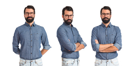 arm in arm: Young hipster man with his arms crossed Stock Photo