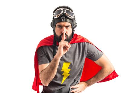 Superhero making silence gesture
