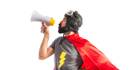 superhero: Superhero shouting by megaphone