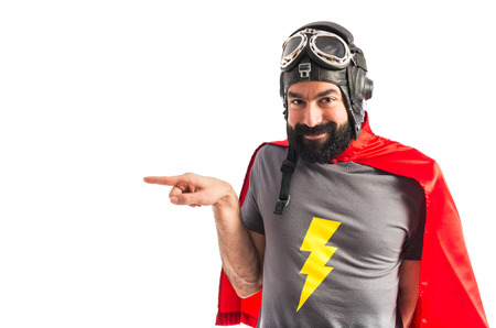 Superhero pointing to the lateral Standard-Bild