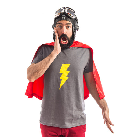 Superhero doing surprise gesture Stock Photo