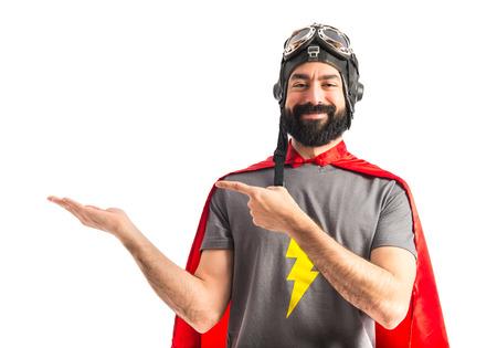 Superhero holding something Foto de archivo