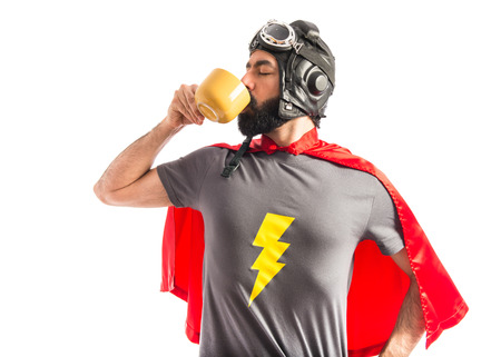 Super hero holding a cup of coffee Stock Photo - 40412323