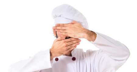 covering: Chef covering his face