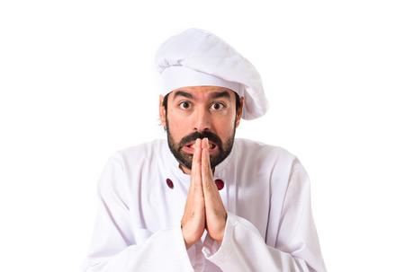 pleading: Chef pleading over white background