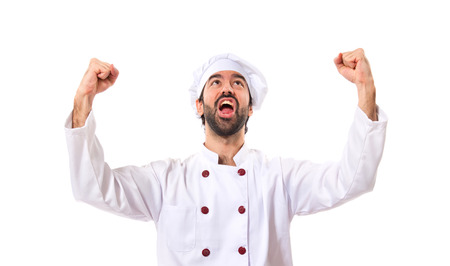 first floor: Lucky chef over isolated white background Stock Photo