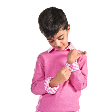 preppy: Portratit of young boy with pink sweater Stock Photo