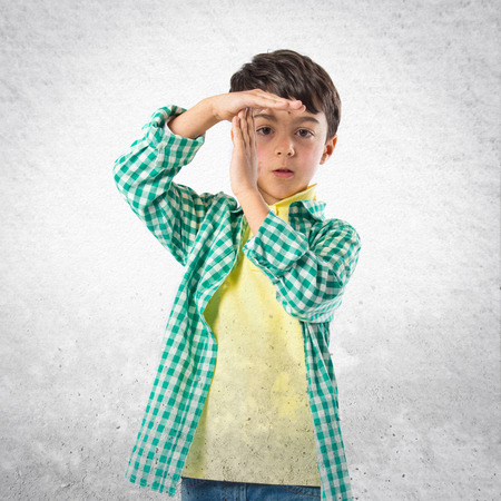 interruption: Kid making time out gesture over white background