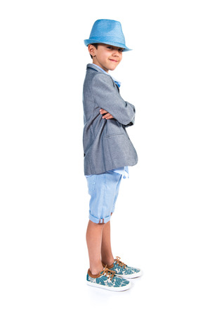 7 year old boys: Child with his arms crossed wearing a blue hat
