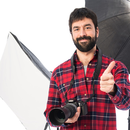 Photographer in his studio with thumb up photo