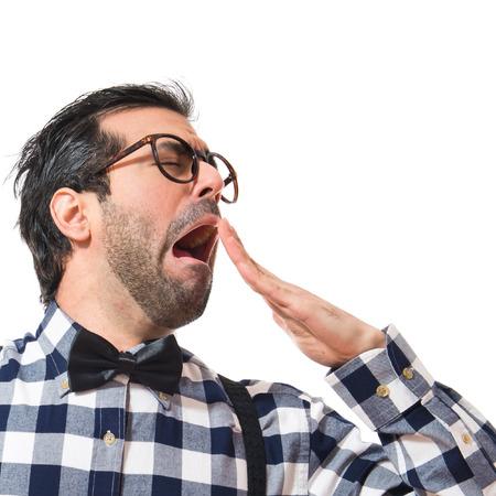 posh: Posh boy yawning over white background