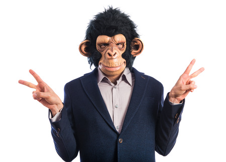 Monkey man doing victory gesture Stock Photo - 40925830