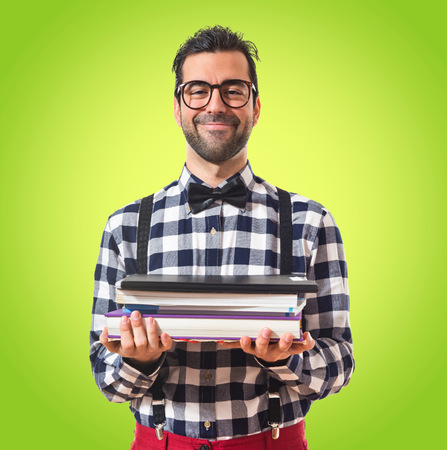 latin students: Posh boy holding books