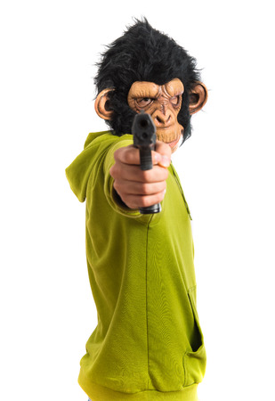 holding gun to head: Monkey man shooting with a pistol