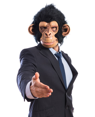 deal making: Monkey man making a deal Stock Photo