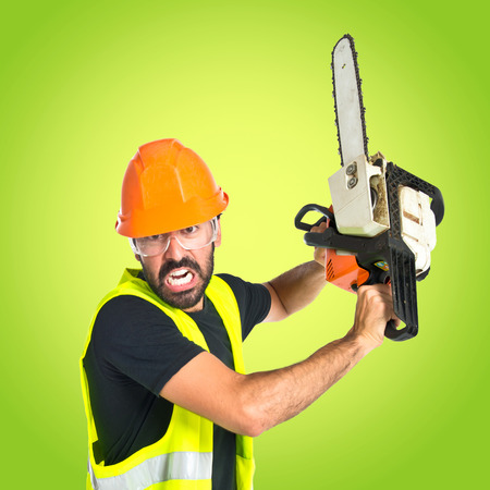 man power: Workman with chainsaw over white background Stock Photo