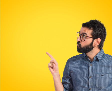 thinking: Young hipster man thinking over white background