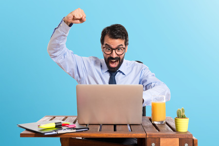 great success: Lucky businessman in his office Stock Photo