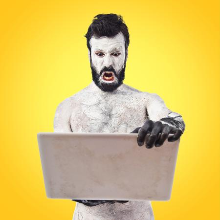 civilisation: Old civilisation man with laptop