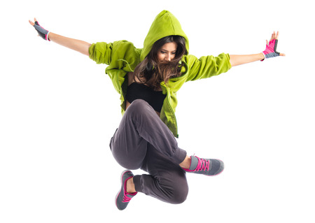 hip hop dancing: Teenager girl jumping in street dance style Stock Photo