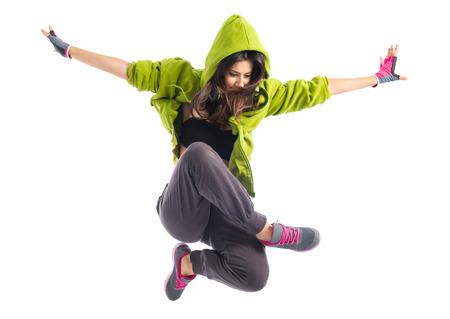 Teenager girl jumping in street dance style Standard-Bild