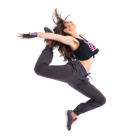 Teenager girl jumping in hip hop style Banco de Imagens